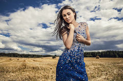 Young sensual & beauty woman in a fashionable dress pose outdoor. Royalty Free Stock Photo