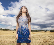 Young sensual & beauty woman in a fashionable dress pose outdoor. Stock Photo