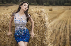 Young sensual & beauty woman in a fashionable dress pose outdoor. Stock Photography