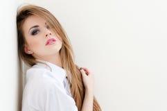 Young sensual business woman wearing man's shirt on white copyspace Stock Photos