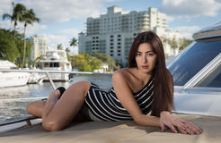 Sensual woman in a boat Stock Photos