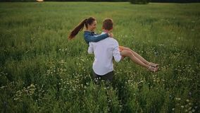 Young sensual couple in love kissing and feeling happy n summer field rainy weather stock footage