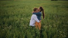 Romantic couple portrait of two people kissing silhouette white young sensual couple in love kissing and feeling happy n summer field rainy weather stock footage altavistaventures Image collections