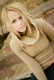 Young sensual girl blonde in windy fall outdoors Royalty Free Stock Photography