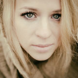 Young sensual girl blonde in windy fall outdoors Royalty Free Stock Photos