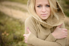 Young sensual girl blonde in windy fall outdoors Stock Images
