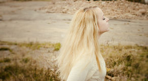 Young sensual girl blonde in windy fall outdoors Royalty Free Stock Photo