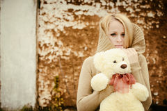 Young sensual girl blonde in windy fall with toy Stock Photo