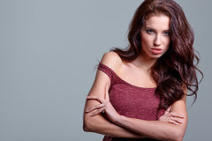 Young sensual girl in fashion clothes pose in studio Royalty Free Stock Photography