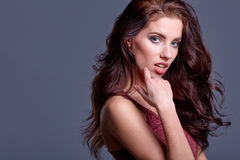 Young sensual girl in fashion clothes pose in studio Stock Image