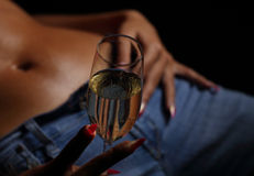 Young sensual girl holging a glass. With campagne Stock Photography
