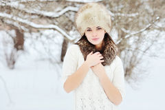 Young sensual girl in winter. Beautiful brunette posing outdoor Stock Photography