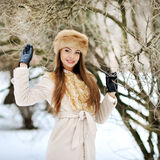 Young sensual girl in winter park - outdoors. Young sensual girl in winter park - outdoor Royalty Free Stock Photography
