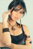 Young sensual italian woman with accessories. Black hair Royalty Free Stock Images