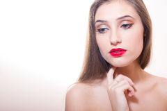 Young sensual lady with finger on her chin royalty free stock photography