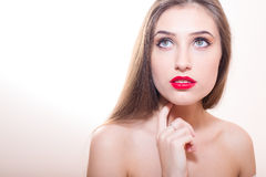 Young sensual lady with finger on her chin Royalty Free Stock Image