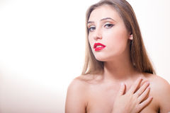 Young sensual lady with finger on her chin Royalty Free Stock Images