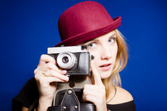 Young sensual lady in red hat with retro camera Royalty Free Stock Photo
