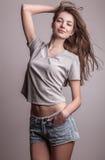 Young sensual model girl pose in studio. Royalty Free Stock Photos