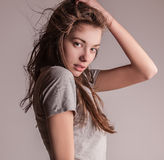 Young sensual model girl pose in studio. Royalty Free Stock Photo