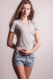 Young sensual model girl pose in studio. stock images