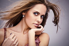 Young sensual model girl pose in studio. Stock Photo