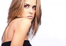 Young sensual model girl pose in studio. Royalty Free Stock Image