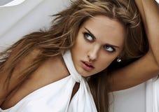 Young sensual model girl pose in studio. Stock Photos