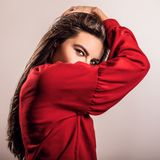 Young sensual model woman in red pose in studio. Stock Photos