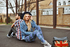 Young sensual romantic couple sitting on the ground Stock Photography