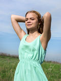 Young sensual smiling blonde posing in bright sunlight outdoors Royalty Free Stock Images