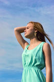 Young sensual smiling blonde posing in bright sunlight outdoors Stock Photography