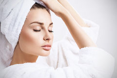 Young sensual woman with bath towel on head. Royalty Free Stock Photo