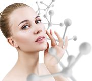 Young sensual woman with big white molecule chain. Stock Photos
