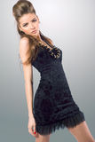 Young sensual woman in black dress Stock Image