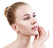 Young sensual woman with cream on face. royalty free stock images