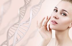 Portrait of sensual woman in DNA chains. Young sensual woman in DNA chains over beige background. Biochemistry skin concept royalty free stock image