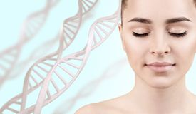 Young sensual woman in DNA chains. Young sensual woman in DNA chains over blue background. Biochemistry skin concept stock images