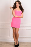 Young sensual woman in pink decollete gown Stock Photography