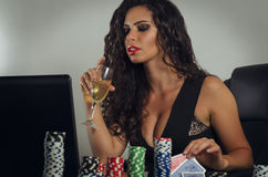 Young sensual woman playing poker online Royalty Free Stock Image