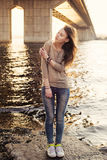 Young sensual woman standing on the stone near water Stock Photos