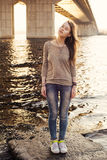 Young sensual woman standing on the stone near water Royalty Free Stock Photo