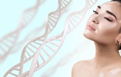 Young sensual woman with vitiligo in DNA chains. Over blue background. Biochemistry skin concept royalty free stock image