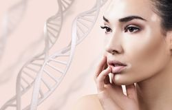 Young sensual woman with vitiligo in DNA chains. Over white background. Biochemistry skin concept Royalty Free Stock Photo