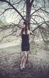 Young sensual woman in wood harmony with nature Royalty Free Stock Photography