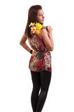 Young sensual woman yellow with bouquet of daffodils on her shou Stock Images