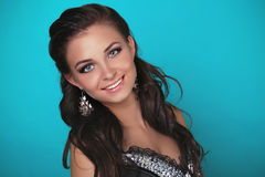 Young sensuality beautiful teen with smile. Blue background Royalty Free Stock Photography