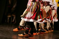 Young Serbian dancers in traditional costume. Folklore of Serbia.  stock photo