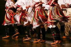 Young Serbian dancers in traditional costume. Folklore of Serbia.  royalty free stock photos