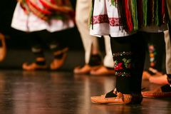 Young Serbian dancers in traditional costume. Folklore of Serbia.  royalty free stock image